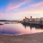 Panoramic view of Antibes on sunset from Plage de la Gravette, French Riviera, France